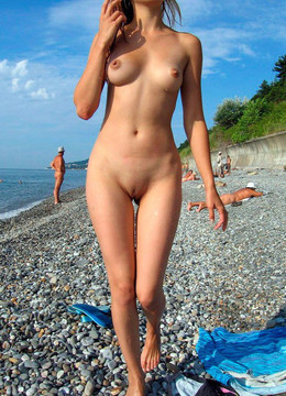 Teeny girls naked on a beach.